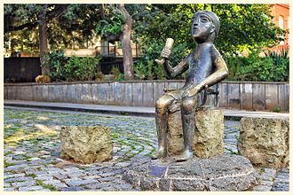 """Tamada - The sculpture of a man holding a horn in Tbilisi modeled on an ancient Colchian statuette affectionately monikered as """"tamada""""."""