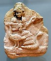 Terracotta plaque showing seated goddess Nanshe and geese. from southern Iraq. 2003-1595 BCE. Iraq Museum.jpg