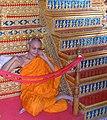 Thai monk sits.jpg