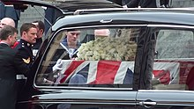 Thatcher funeral, coffin loaded in hearse.jpg