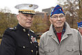 The Assistant Commandant of the Marine Corps, Gen. John M. Paxton, Jr., left, poses for a photo with a Marine veteran during an Honor Flight event at the Marine Corps War Memorial in Arlington, Va., Sept 131112-M-KS211-015.jpg
