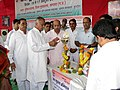 """The Member of Parliament, Shri Nand Kumar Singh Chouhan lighting the lamp to inaugurate the """"Sabka Saath-Sabka Vikas Public Information Campaign"""", organised by the PIB Indore, at Khandwa (MP) on October 15, 2014.jpg"""