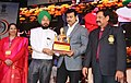 The Minister of State for Youth Affairs and Sports (IC) and Information & Broadcasting, Col. Rajyavardhan Singh Rathore presenting the awards, at the Closing Ceremony of the 22nd National Youth Festival (3).jpg