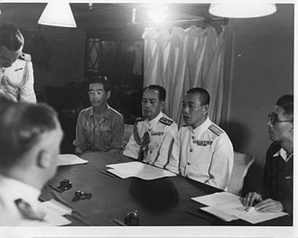 Operation Jurist - Rear Admiral Jisaku Uozomi (second from right) discussing the surrender of Penang with Vice Admiral Harold Walker aboard HMS Nelson.