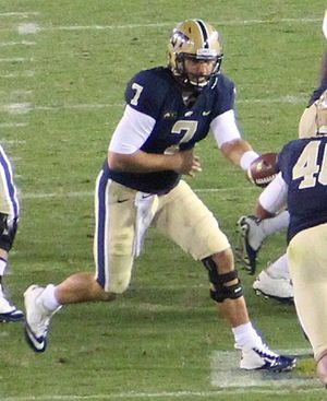 2013 Pittsburgh Panthers football team - Pitt starting quarterback Tom Savage handing off during the Georgia Tech game