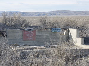 Topaz War Relocation Center - Remains of sewage pump house at Topaz. The small memorial sign at the right notes that internee James Wakasa was killed near this spot.