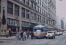Trolley car passing downtown Pittsburgh Kaufmann's store, 1984.jpg