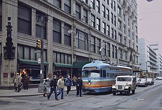 Kaufmann's - The flagship store in downtown Pittsburgh in 1984, with a trolley car stopping in front