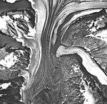 Tsirku Glacier, valley glaciers with a large medial moraine, September 17, 1966 (GLACIERS 5262).jpg
