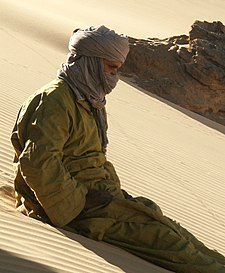 Algerian Tuareg sitting on the sand.