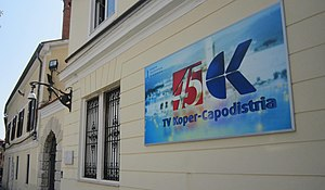 TV Koper-Capodistria - Tarsia Palace, historical HQ of TV Koper-Capodistria (photo from 2016, showing the logo of the channel in its 45th anniversary)