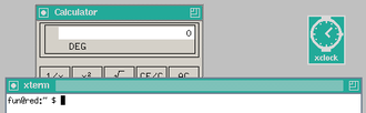 Twm - twm with xcalc and xterm, the xterm window being in focus. xclock is iconified.