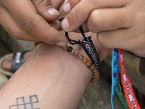 Friendship bracelet - Tying a friendship bracelet.