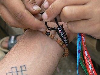 Friendship bracelet - Tying a friendship bracelet.