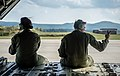 U.S. Air Force Airman 1st Class Emily Mitchell and Senior Airman Christian McDevitt, both loadmasters with the 37th Airlift Squadron, wait to taxi on the runway aboard a C-130J Super Hercules aircraft 140905-F-YC884-148.jpg