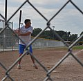 U.S. Coast Guard Lt. Cmdr. Jason Biggar, the chief of the planning department at Coast Guard Civil Engineering Unit Cleveland, takes a turn at bat during his unit's softball practice July 31, 2013 130731-G-KB946-072.jpg