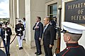 U.S. Defense Secretary Ash Carter, left, and French Defense Minister Jean-Yves Le Drian stand as the U.S. and French national anthems play during an honor cordon before the two leaders met to discuss matters 150706-D-NI589-063c.jpg