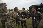 U.S. Marine Corps Master Sgt. Jason Ventura, front left, a maintenance chief with Marine Air Control Squadron (MACS) 4, assigned to the aviation combat element of the 3rd Marine Expeditionary Brigade, III Marine 131004-M-GX379-927.jpg