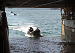 U.S. Marine Corps assault amphibious vehicles enter the well deck of the amphibious dock landing ship USS Tortuga (LSD 46) after a joint amphibious assault exercise with the Royal Thai Navy as part 130609-N-IY633-205.jpg