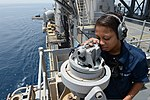 U.S. Navy Boatswain's Mate Seaman Apprentice Jamiqua Pearson, assigned to the amphibious assault ship USS Kearsarge (LHD 3), uses a telescopic alidade to take a navigational bearing as the ship transits the Bab 130602-N-NK134-291.jpg