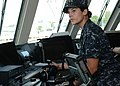 U.S. Navy Ensign Kelly Reightler uses the integrated bridge system to perform a course correction aboard the littoral combat ship USS Freedom (LCS 1) as the ship gets underway in Singapore May 21, 2013 130521-N-PD773-058.jpg
