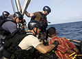 U.S. Navy and Marine Corps visit, board, search and seizure team members stationed aboard the guided missile cruiser USS San Jacinto (CG 56) stand guard over suspected pirates on board a dhow as they travel 100527-N-EF447-011.jpg