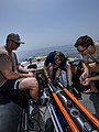U.S. Navy explosive ordnance disposal (EOD) technicians assigned to Explosive Ordnance Disposal Mobile Unit 6 and EOD Training and Evaluation Units 1 and 2 attach a cable to a Sea Fox remotely operated mine 130516-N-OM642-178.jpg
