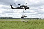 UH-60 transporting sling load (33913349783).jpg