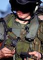 US Navy 030206-N-4048T-077 A U.S. Marine Crew Chief loads ammunition into the magazine of an M-16 rifle.jpg