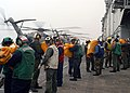 US Navy 030327-N-1512S-003 The flight deck crew offloads mail during flight quarters aboard USS Kearsarge (LHD 3).jpg