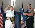 US Navy 030817-N-8852W-001 Petty Officer First Class Richard Sweet of Warren, Ohio, is reenlisted by Diamond Dallas Page, three-time world champion of World Championship Wrestling (WCW).jpg