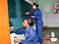 US Navy 040707-N-8053T-006 Yeoman 1st Class Monique Hoilett of Queens, N.Y. and yeoman 2nd Class Clarissa Lee from Red Mesa, Ariz., apply fresh paint to the chalkboards at a local school, during UNITAS 45-04.jpg