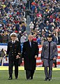 US Navy 041204-N-2383B-207 President Bush escorted to mid-field at 105th Army Navy game.jpg