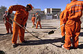 US Navy 041213-N-4614W-029 Twenty-two Iraqi contracted nationals, working with brooms and shovels, clear nearly three blocks of broken walls, glass and trash along a major thoroughfare in the city of Fallujah, Iraq.jpg