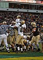 US Navy 051203-N-2653P-456 Navy Quarterback Lamar Owens from Savannah, Ga., celebrates with fellow players following his touchdown during first half play at the 106th Army vs. Navy Football game.jpg