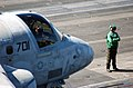 US Navy 060309-N-7241L-001 A flight deck crew member waits for an S-3B Viking assigned to the.jpg