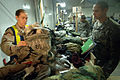 US Navy 061212-N-8148A-019 A soldier assigned to Army 82nd Airborne Division stands by and observes as his personal belongings are searched and inspected by Customs Border Clearance Agent Mass Communication Specialist 3rd Class.jpg