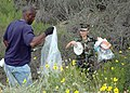 US Navy 070420-N-6357K-002 Chief Master-at-Arms Rodney Richardson and Seaman Kimngan Nguyen remove trash from remote areas of Naval Base Point Loma during the base's Earth Day Celebration.jpg