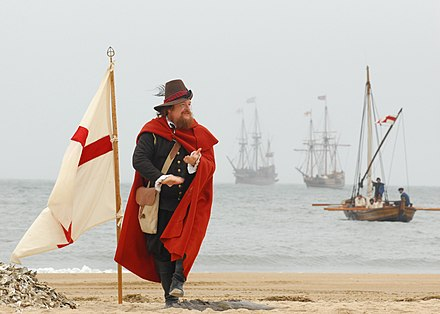 An actor playing John Smith simulates claiming a beach for England in the New World in a historical reenactment US Navy 070426-N-1688B-163 John Smith, played by Dennis Farmer, claims the beach for England during a re-enactment ceremony on the 400th anniversary of the First Landing.jpg