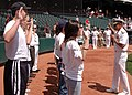 US Navy 070604-N-8497H-038 Director of Global Operations (J3), United States Strategic Command, Rear Adm. Doug McClain swears in new Sailors in the delayed entry program before a Redhawks game.jpg