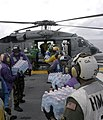 US Navy 070907-N-1189B-125 crew members load bottled water onto an MH-60S Seahawk helicopter during Hurricane Felix disaster relief operations.jpg