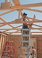 US Navy 070909-N-3560G-074 Builder 3rd Class Mason Lynn, assigned to Naval Mobile Construction Battalion (NMCB) 4, constructs the roof on a berthing facility.jpg