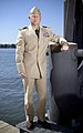 US Navy 070919-N-5319A-011 A Sailor shows off the prototype uniform for service dress khaki, a throwback to the traditional WWII style uniform.jpg