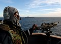 US Navy 080126-N-7981E-606 Gunner's Mate Seaman James Greer stands watch as part of the Small Craft Action Team aboard the guided missile cruiser USS Momsen (DDG 92) during a straight transit exercise.jpg