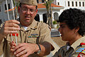 US Navy 080630-N-3289C-061 Senior Chief Operations Specialist Phillip Heldt, assigned to Naval Station Rota, explains how to properly raise the National Ensign to Brennan Outar of Boy Scout Troop 73.jpg
