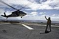 US Navy 080924-M-1294R-046 Aviation Boatswain's Mate (Handling) 3rd Class Arata Bernard signals the departure of an SH60 Sea Hawk helicopter.jpg