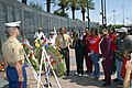 US Navy 090525-N-8590G-003 Cmdr. Carol Schrader, executive officer of Naval Air Station Jacksonville, escorts members of the Reed family to Veterans Memorial Wall during a wreath presentation.jpg