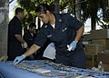 US Navy 090526-N-7415V-007 Musician 1st Class Luslaida Barbosa arranges sanitized dental instruments during a Cooperation Afloat Readiness and Training (CARAT) 2009 medical civic action program.jpg