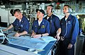 US Navy 090626-N-4774B-036 Navigation officer Lt. Michael Hurban, center, digitally charts a course on the bridge of the guided-missile cruiser USS Lake Champlain (CG 57).jpg