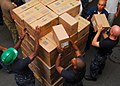 US Navy 100827-N-4044H-188 Sailors embarked aboard HMAS Tobruk (L 50) separate a pallet of medical supplies.jpg